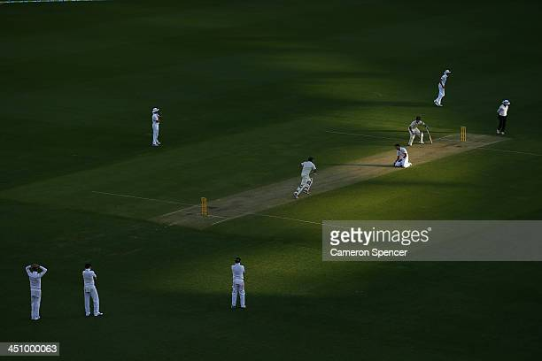 James Anderson of England bowls to Ryan Harris of Australia during day one of the First Ashes Test match between Australia and England at The Gabba...