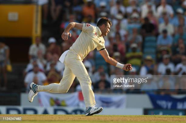 James Anderson of England catches West Indies captain Jason Holder during Day One of the First Test match between England and West Indies at...