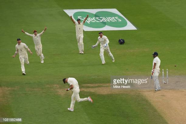 James Anderson of England celebrates after bowling Mohammed Shami of India to become the leading fast bowler in Test history during the Specsavers...