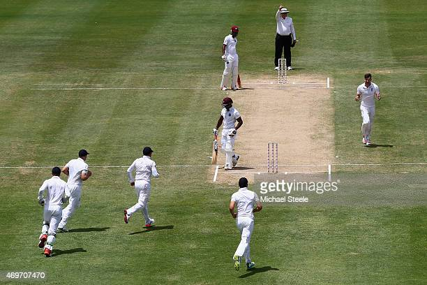 James Anderson of England celebrates after taking the wicket of Devon Smith of West Indies during day two of the 1st Test match between West Indies...