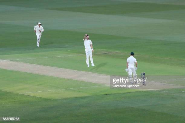James Anderson of England celebrates after taking the wicket of Cameron Bancroft of Australia during day three of the Second Test match during the...