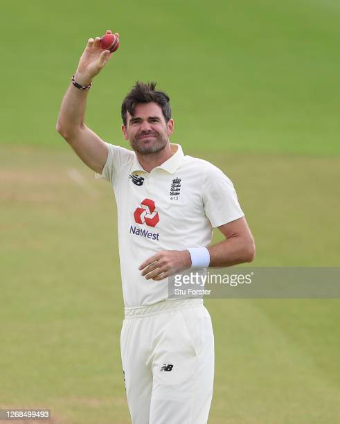 James Anderson of England celebrates and holds the ball aloft after taking the wicket of Azhar Ali of Pakistan to reach 600 Test Match wickets during...