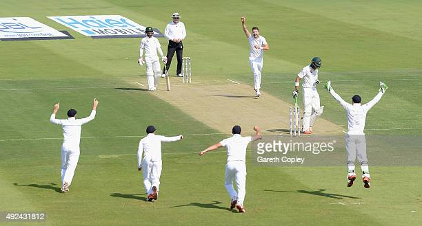 James Anderson of England celebrates bowling Shan Masood of Pakistan during the 1st Test between Pakistan and England at Zayed Cricket Stadium on...