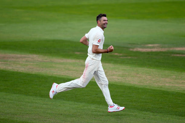 He bowls for England and celebrates taking the final wicket of Mohammed Shami to become the record test wicket taker for a pace bowler during day...