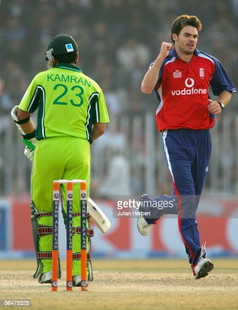 James Anderson of England celebrates taking the wicket of Kamran Akmal during the fifth One Day International between Pakistan and England played at...