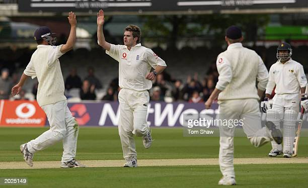 James Anderson of England celebrates taking the wicket of Mark Vermeulen during the second day of the first npower Test match between England and...