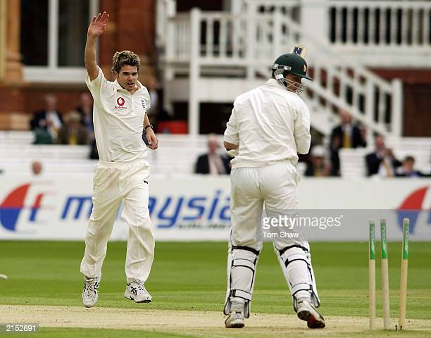 James Anderson of England celebrates taking the wicket of Travis Friend of Zimbabwe during the third day of the first npower Test match between...
