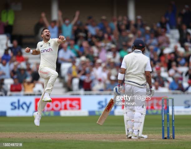 James Anderson of England celebrates taking the wicket of Virat Kohli of India during day two of the First LV= Insurance test match between England...