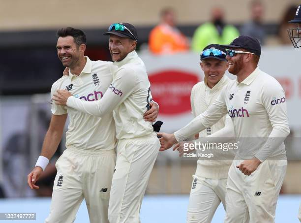 James Anderson of England celebrates taking the wicket of Virat Kohli of India with captain Joe Root during day two of the First LV= Insurance test...