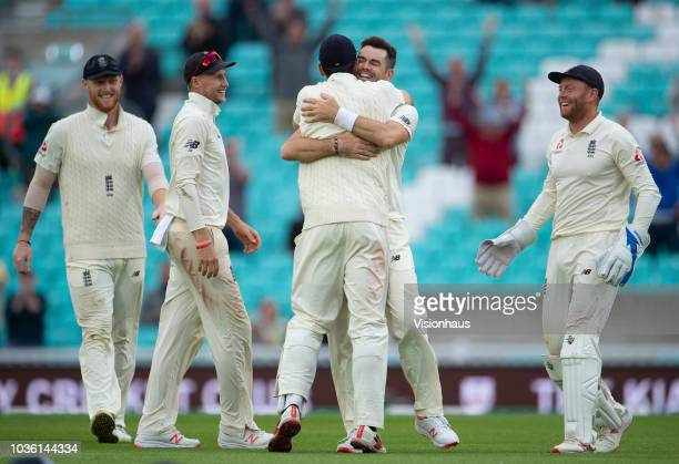 James Anderson of England celebrates with Alastair Cook after bowling Mohammed Shami of India and in doing so taking his 564 test wicket during the...