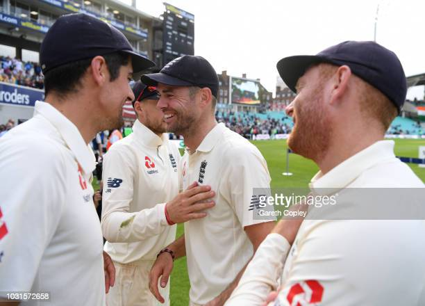 James Anderson of England celebrates with Alastair Cook Joe Root and Jonathan Bairstow after winning the Specsavers 5th Test match between England...