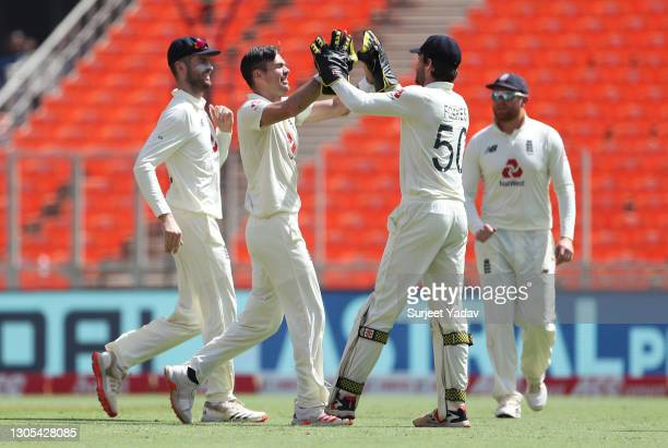 James Anderson of England celebrates with Ben Foakes after taking the wicket of Ajinkya Rahane of India during Day Two of the 4th Test Match between...