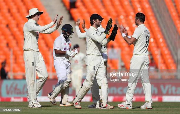 James Anderson of England celebrates with Ben Foakes after taking the wicket of Rishabh Pant of India during Day Two of the 4th Test Match between...