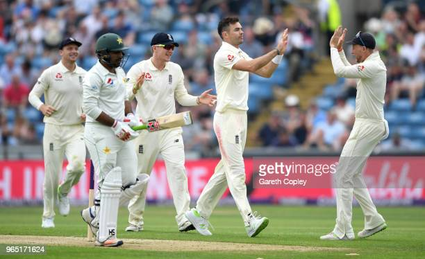 James Anderson of England celebrates with captain Joe Root after dismissing Pakistan captain Sarfraz Ahmed during the 2nd NatWest Test match between...