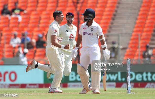 James Anderson of England celebrates with Dom Sibley after taking the wicket of Ajinkya Rahane of India during Day Two of the 4th Test Match between...