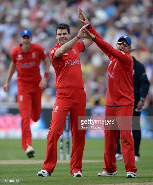 James Anderson of England celebrates with Ian Bell after dismissing Mitchell Marsh of Australia during the ICC Champions Trophy group A match between...