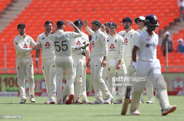 James Anderson of England celebrates with Jack Leach, Ben Stokes and teammates after taking the wicket of Ajinkya Rahane of India during Day Two of...