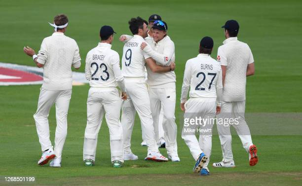 James Anderson of England celebrates with Joe Root and teammates after taking the wicket of Azhar Ali of Pakistan to reach 600 Test Match Wickets...