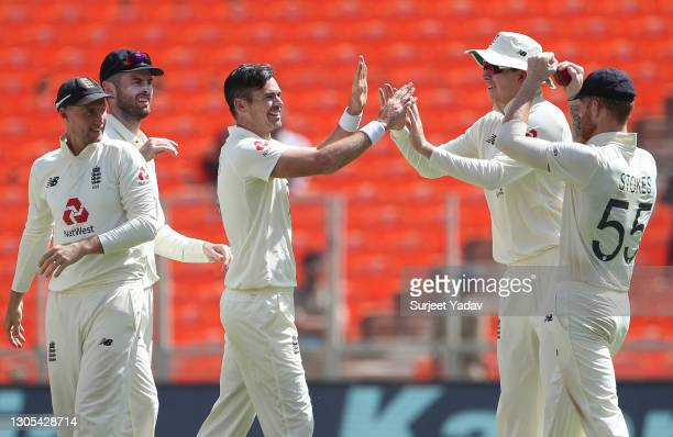 James Anderson of England celebrates with Joe Root, Dom Sibley, Zak Crawley and Ben Stokes after taking the wicket of Ajinkya Rahane of India during...