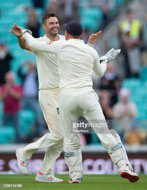 James Anderson of England celebrates with Jonny Bairstow after bowling Mohammed Shami of India and in doing so taking his 564 test wicket during the...