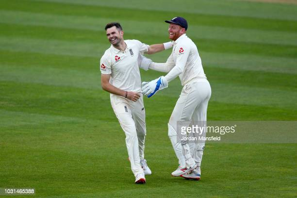 James Anderson of England celebrates with Jonny Bairstow of England after taking the final wicket of Mohammed Shami to become the record test wicket...