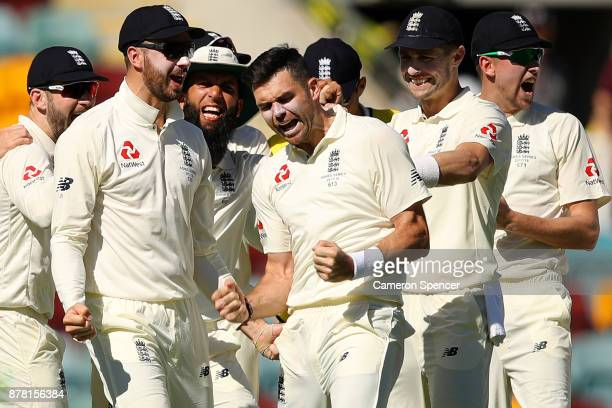 James Anderson of England celebrates with team mates after a successful DRS appeal for the dismissal of Peter Handscomb of Australia for lbw during...
