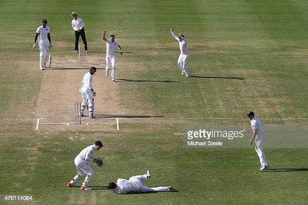 James Anderson of England claims the wicket of Denesh Ramdin of West Indies caught by Alastair Cook at first slip to pass Ian Botham's record of 383...