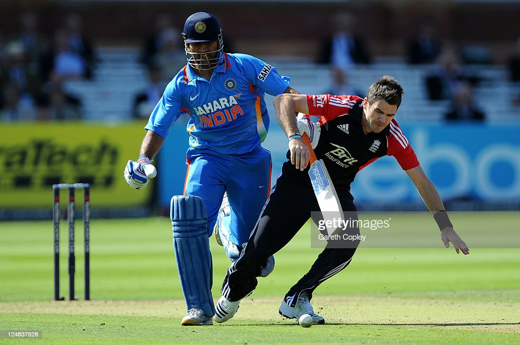 James Anderson (R) of England collides with MS Dhoni of India during the 4th Natwest One Day International match between England and India at Lord's Cricket Ground on September 11, 2011 in London, United Kingdom.