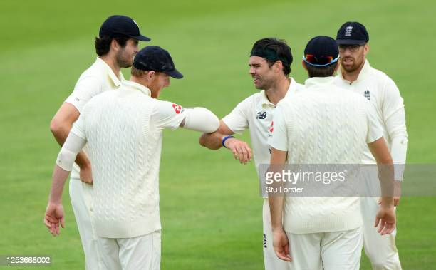 James Anderson of England 'elbow bumps' Ben Stokes after taking the wicket of Joe Denly of England during Day One of a England Warm Up Match at the...