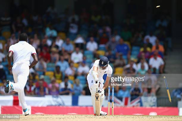 James Anderson of England is bowled by Jerome Taylor of West Indies during day two of the 3rd Test match between West Indies and England at...