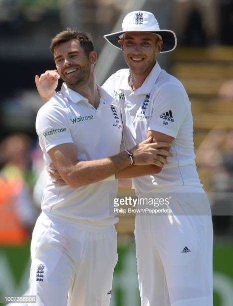 James Anderson of England is congratulated by Stuart Broad after dismissing Mitchell Starc of Australia during the 1st Ashes Test match between...