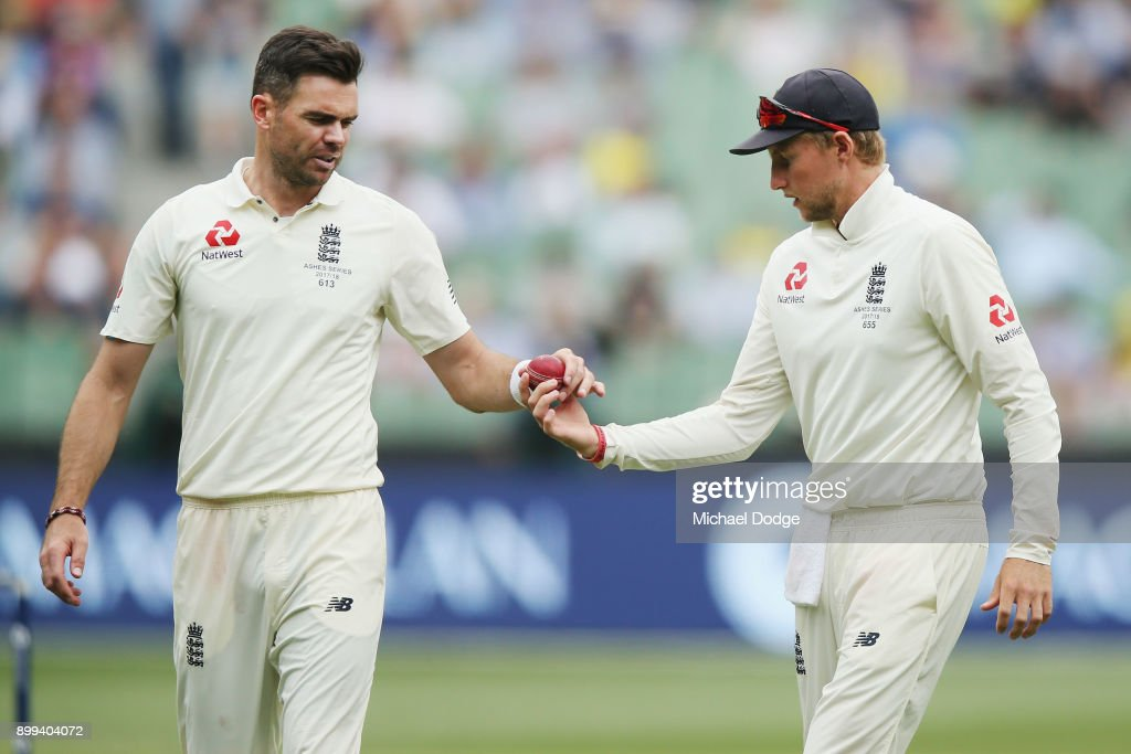 James Anderson of England is given the ball from Joe Root (R) after he shines it during day four of the Fourth Test Match in the 2017/18 Ashes series between Australia and England at Melbourne Cricket Ground on December 29, 2017 in Melbourne, Australia.