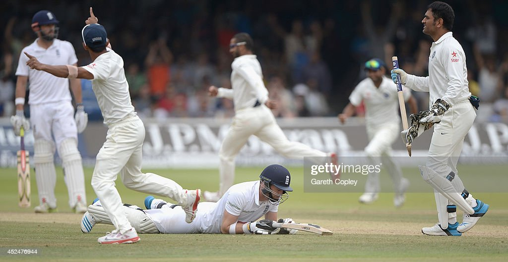 James Anderson of England lies on the ground after being run out as India win the 2nd Investec Test match between England and India at Lord's Cricket Ground on July 21, 2014 in London, United Kingdom.
