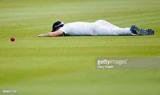 James Anderson of England lies on the ground after dropping a catch during day three of the 1st Investec Test match between England and Sri Lanka at...