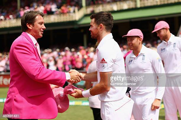 James Anderson of England presents a pink cap to former Australian cricketer Glenn McGrath on Jane McGrath Day during day three of the Fifth Ashes...