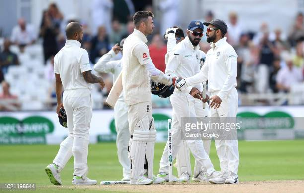 James Anderson of England shakes hands with India captain Virat Kohli after losing the Specsavers 3rd Test match between England and India at Trent...