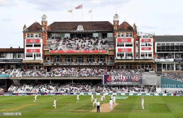 James Anderson of England successfully appeals for the wicket of Cheteshwar Pujara of India during day four of the Specsavers 5th Test match between...
