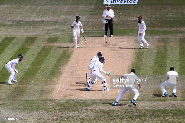 James Anderson of England takes a catch off the bowling of Moeen Ali to dismiss Bhuvneshwar Kumar of India during day five of the 3rd Investec Test...