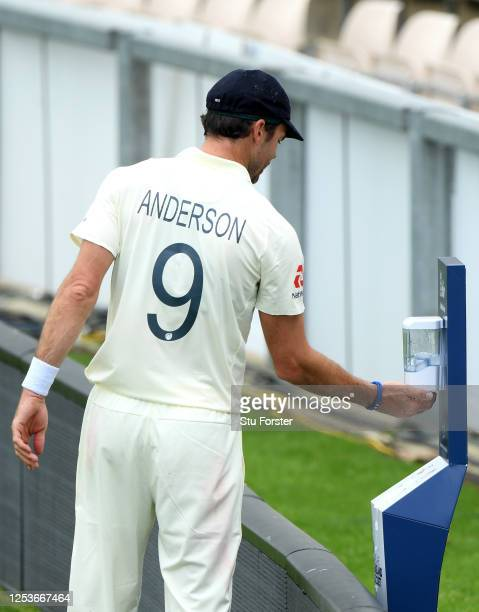 James Anderson of England uses a pitch-side hand sanitation point during Day One of a England Warm Up Match at the Ageas Bowl on July 01, 2020 in...
