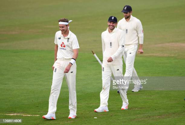 James Anderson of England walks off with Stuart Broad and Chris Woakes after reaching 600 Test Match Wickets at close of play on Day Five of the 3rd...