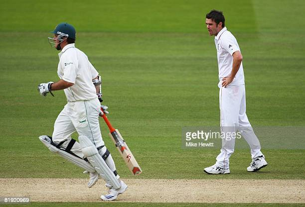 James Anderson of England watches Graeme Smith of South Africa run between the wickets during day four of the First Test match between England and...
