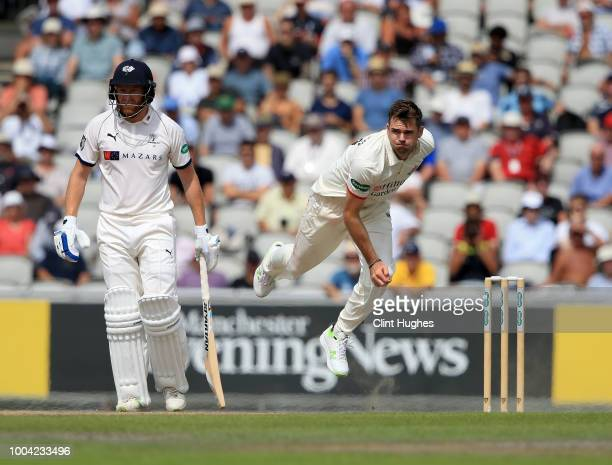 James Anderson of Lancashire bowls as Jonny Bairstow of Yorkshire looks on during day two of the Specsavers County Championship division one match...
