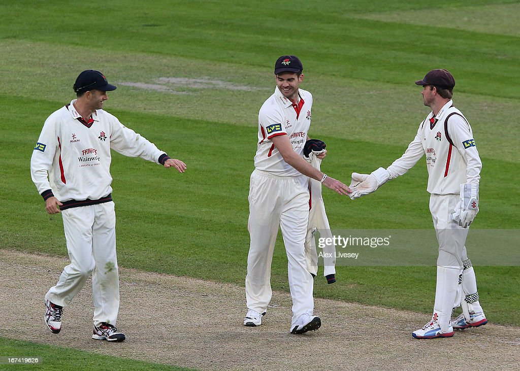 James Anderson of Lancashire is congratulated after taking the last wicket of James Tredwell of Kent during the LV County Championship Division Two match between Lancashire and Kent at Emirates Old Trafford on April 25, 2013 in Manchester, England.