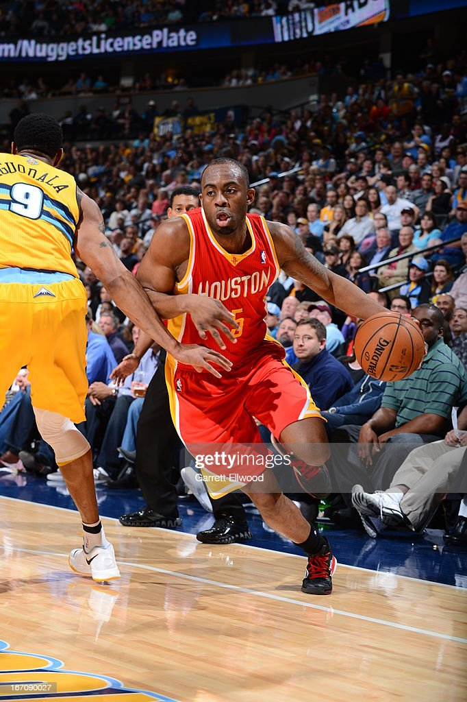 James Anderson #5 of the Houston Rockets drives baseline against the Denver Nuggets on April 6, 2013 at the Pepsi Center in Denver, Colorado.