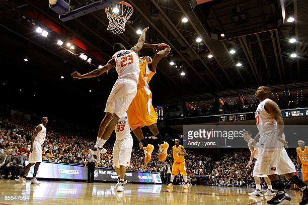 James Anderson of the Oklahoma State Cowboys contests the shot of Terrel Smith of the Tennessee Volunteers during the first round of the NCAA...