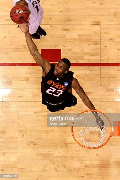 James Anderson of the Oklahoma State Cowboys drives to the hoop against the Pittsburgh Panthers during the second round of the NCAA Division I Men's...
