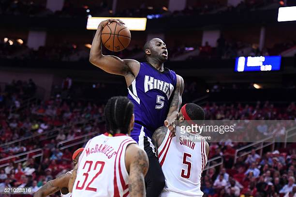 James Anderson of the Sacramento Kings draws a foul from Josh Smith of the Houston Rockets during the second half of a game at the Toyota Center on...