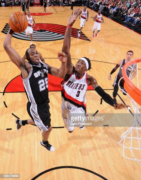 James Anderson of the San Antonio Spurs goes to the basket against Gerald Wallace of the Portland Trail Blazers during the game on February 21 2012...
