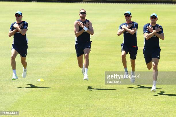 James Anderson Stuart Broad Jake Ball and Craig Overton of England warm up during an England trarining session at the WACA on October 31 2017 in...