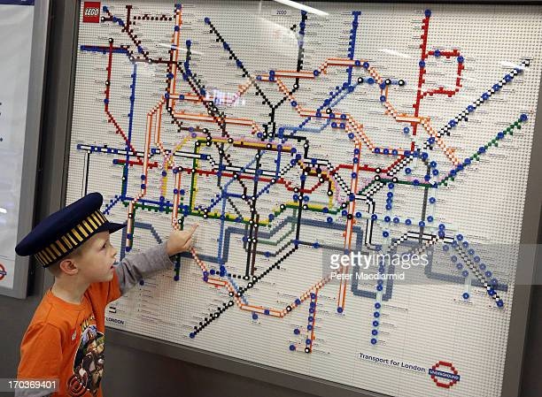 James Apps looks at a Lego tube map showing the future in the year 2020 at Kings Cross Station on June 12 2013 in London England Five tube maps have...